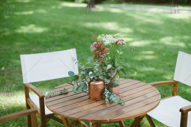 Floral decorations on outdoor table