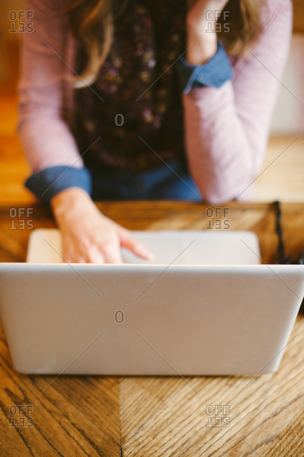A woman on a laptop on table