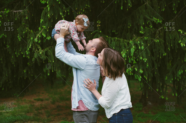 Parents having fun with toddler girl