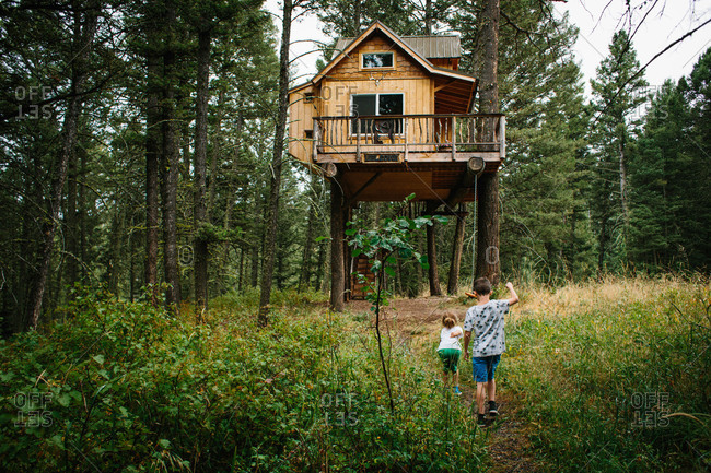 Kids walking to elevated cabin