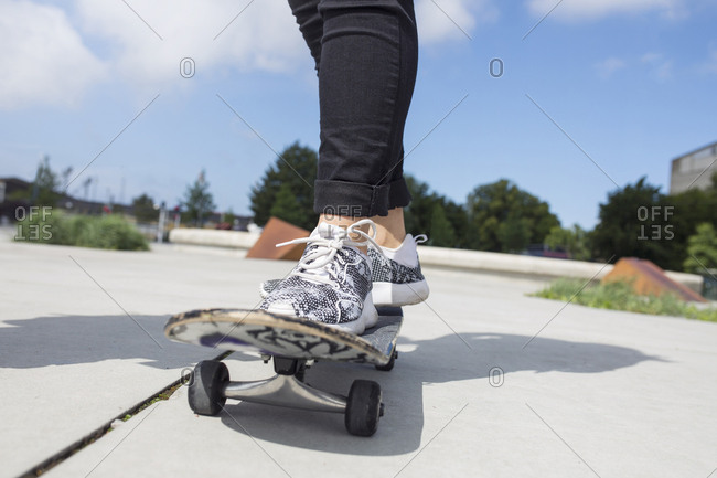 Low section of teenage girl (14-15) on skateboard