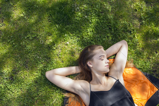High angle view of teenage girl (14-15) resting in park