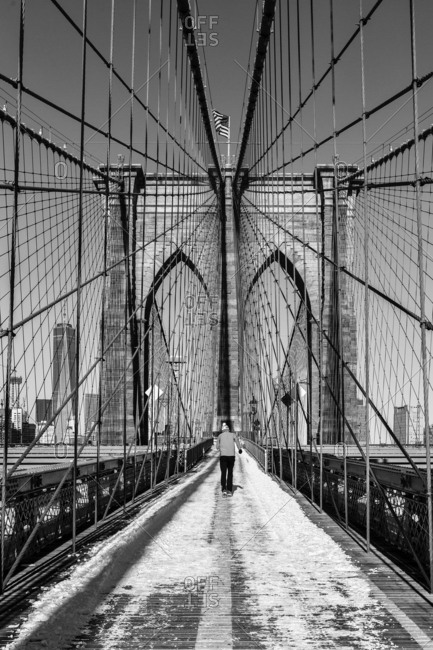 The Brooklyn Bridge is a hybrid cable-stayed/suspension bridge in New York City and is one of the oldest bridges of either type in the United States. Completed in 1883, it connects the boroughs of Manhattan and Brooklyn by spanning the East River