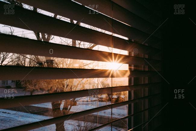 Sun shining through blinds from winter sunrise
