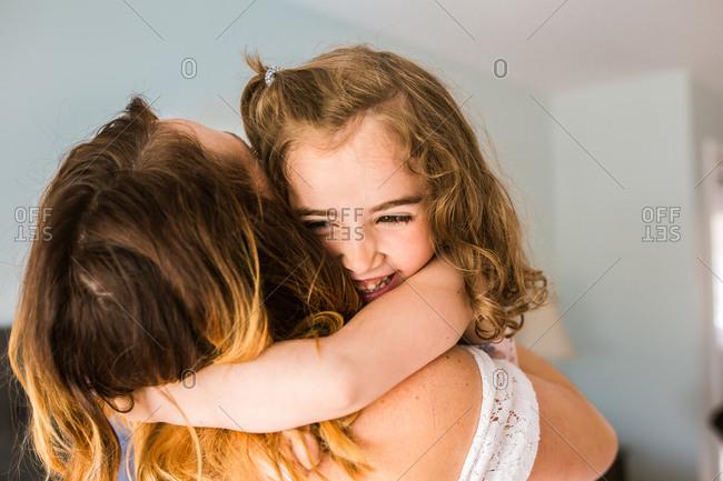 Little girl hugging her mom