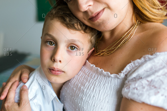 Portrait of mother and son hugging