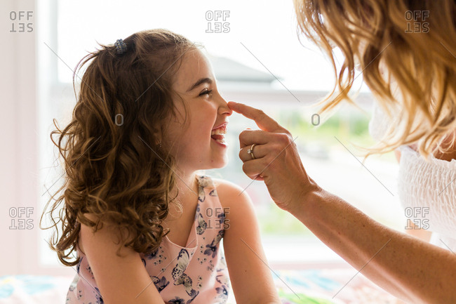 Mother touching her daughter's nose