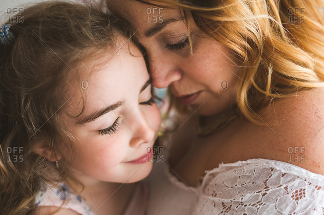 Little girl and her mother embraced