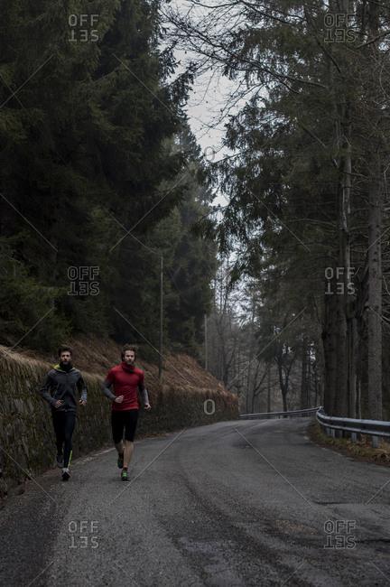 Men jogging on a rural road