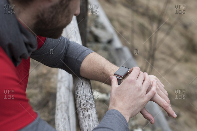 Jogger setting his smartwatch