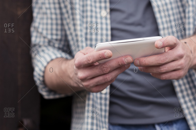 Close up of phone in man's hands