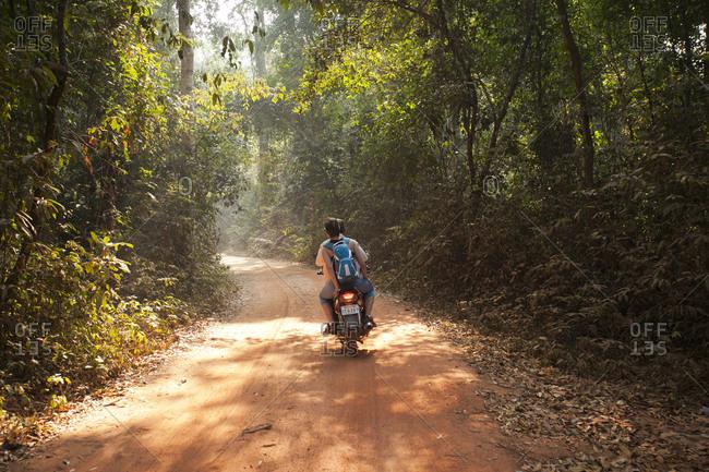 Siem Reap, Cambodia - February 20, 2016: Motoring in the Cambodian jungle