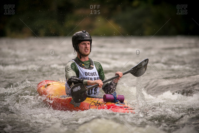 Ocoee River, Georgia, USA - October 8, 2016: Man racing kayak at Ocoee River Race
