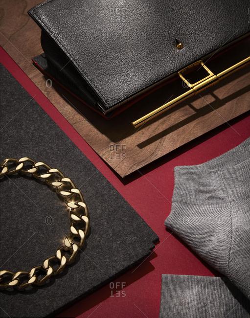 Necklace by a black handbag