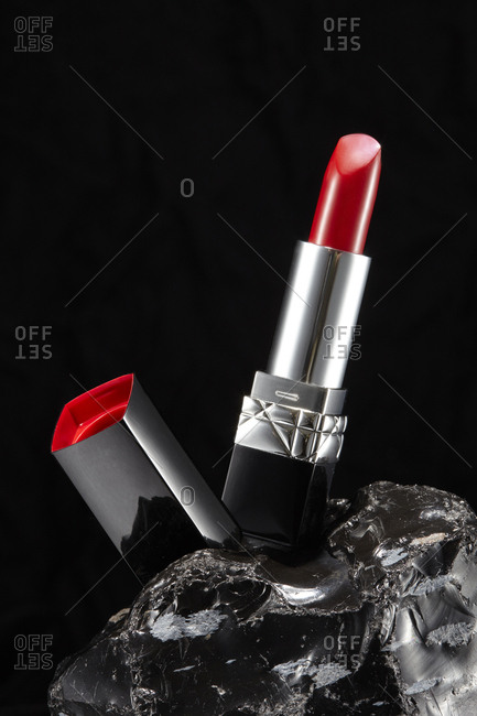 Lipstick tube on black background