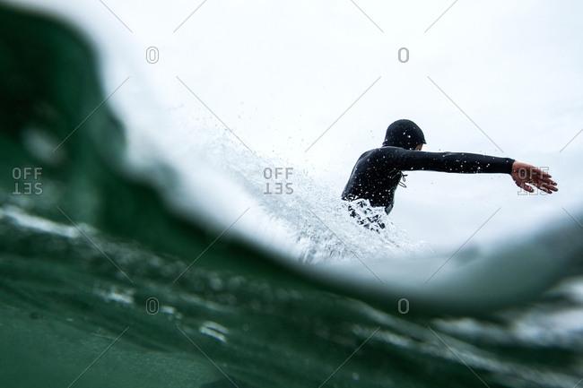 A surfer in splashing water