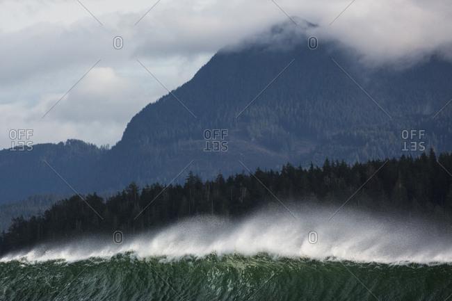 Wave near a mountain shore