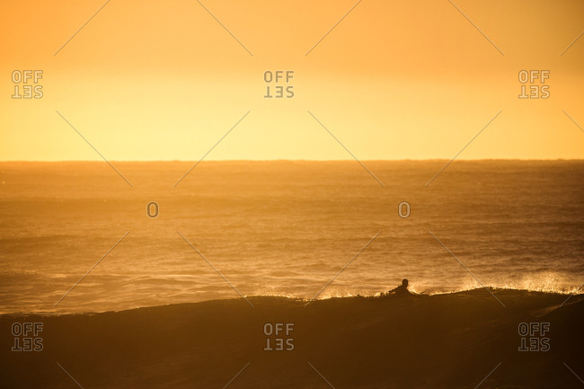 Surfer in golden sunlight