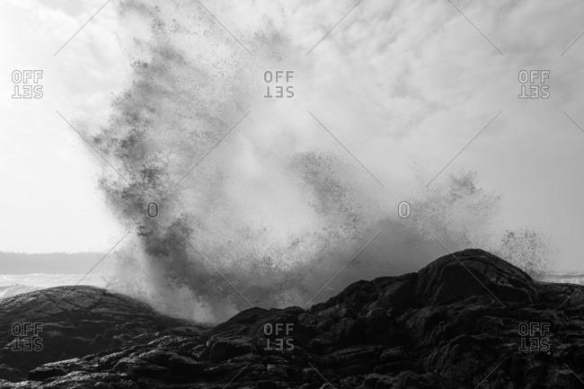 Waves crashing onto rocks on shore