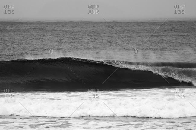 A wave rolling in ocean