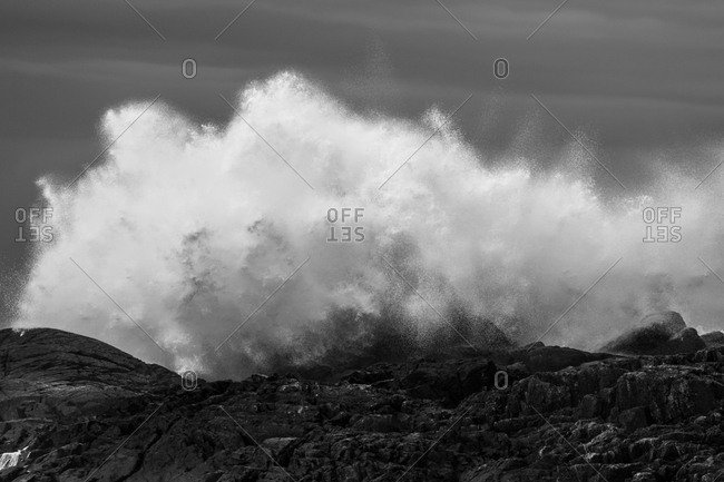 Waves crashing on rock shore