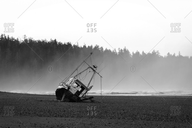 Boat on a shore in black and white