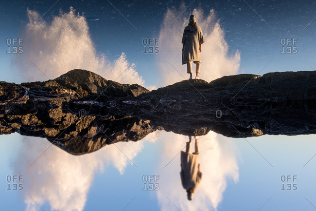 Person by waves in reflection