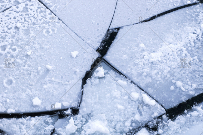 Cracked ice on water surface