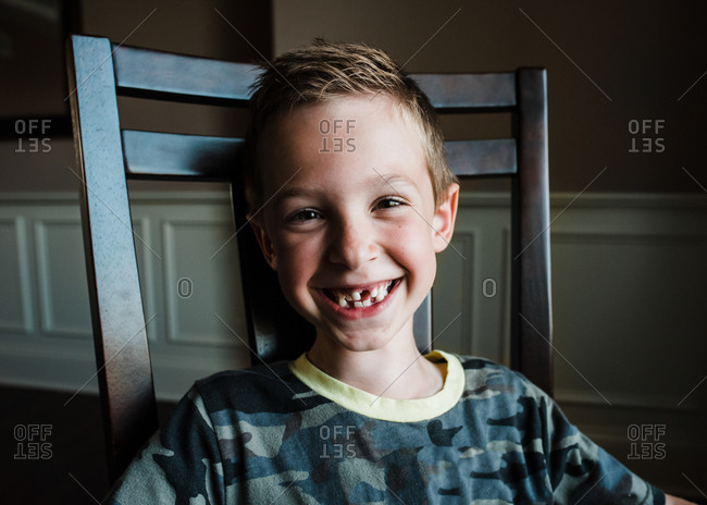Portrait of a little boy missing front tooth