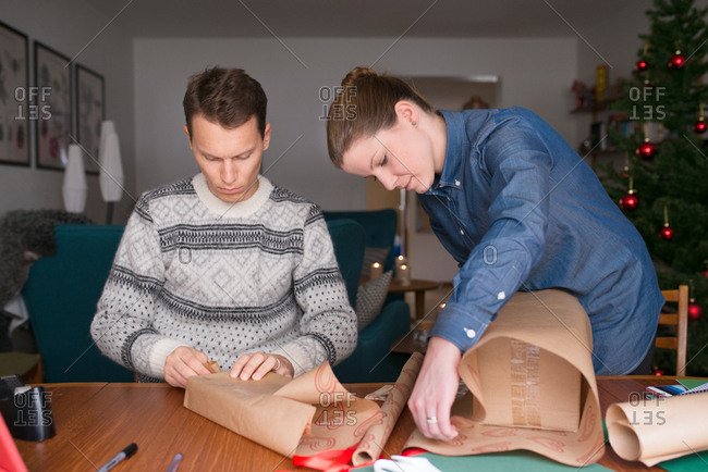 Couple wrapping Christmas gifts