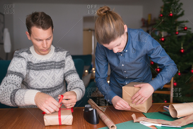 Couple wrapping Christmas presents together