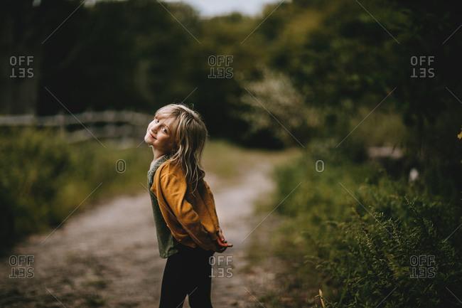 Happy blonde girl in rural setting