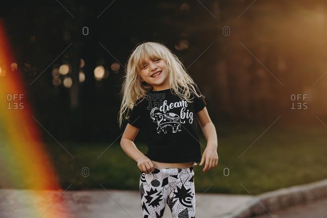 "Happy blonde girl wearing a ""dream big"" shirt"