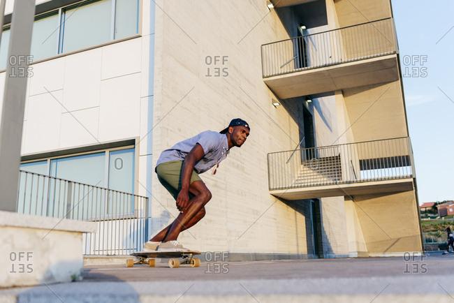 Man riding skateboards at street