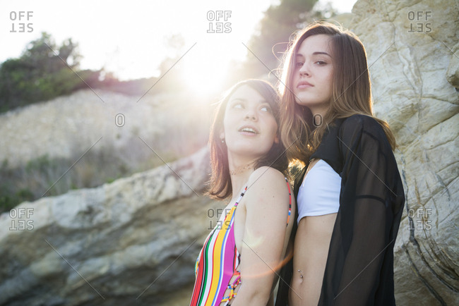 Stylish girls posing on beach
