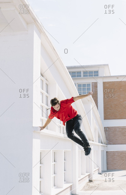 Man jumping on roof
