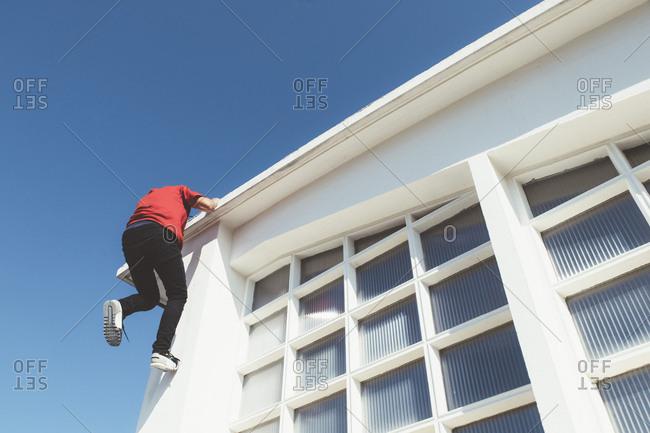 Man climbing on roof
