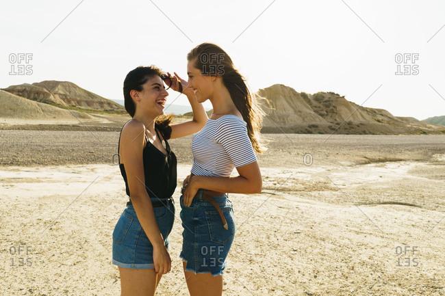 Women posing in sandy hills