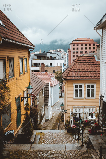 Exterior view of stairs running down street in old beautiful city of Bergen, Norway.