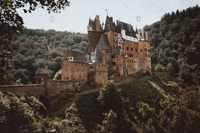 Exterior view of ancient stone castle called Castillo Eltz, Alemania.