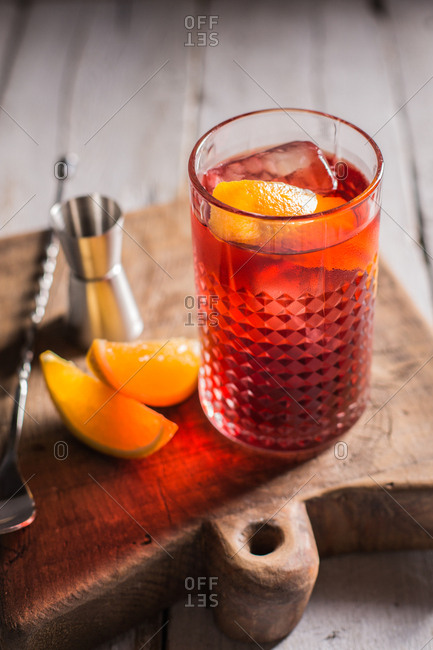 Negroni cocktail (old fashioned) with gin, vermouth and campari, decorated with an orange twist