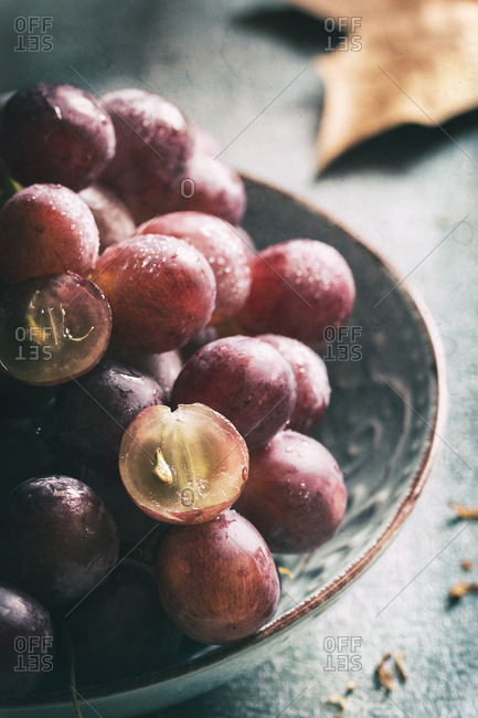 Purple grapes in a bowl. Vertical