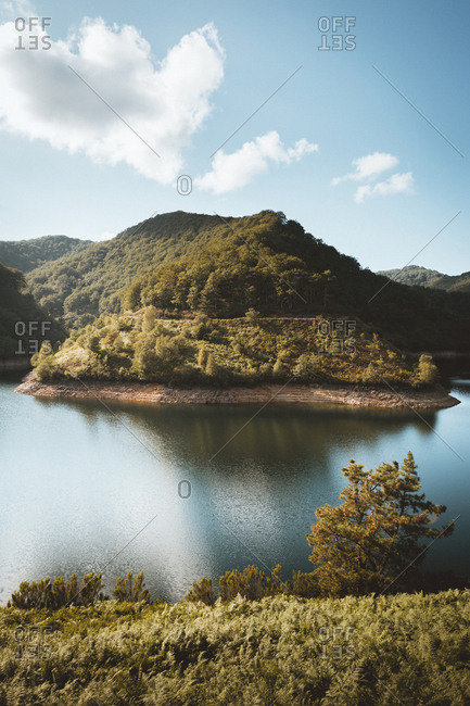 Landscape of green hills and woods on water reservoir AnDarbe, Navarra