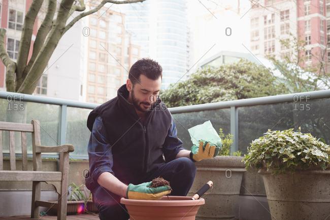 Man potting a plant