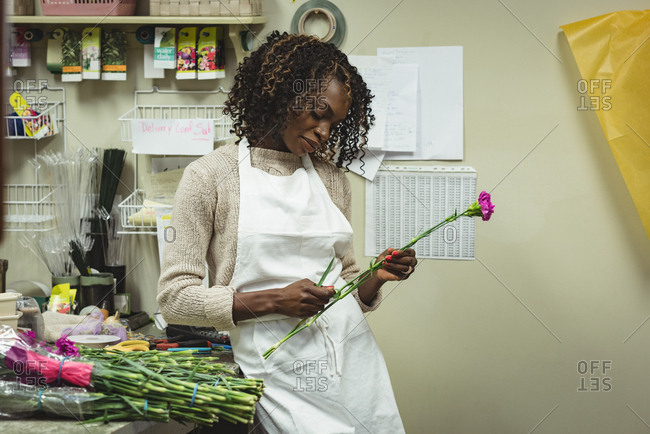 Female florist preparing bouquet of flower