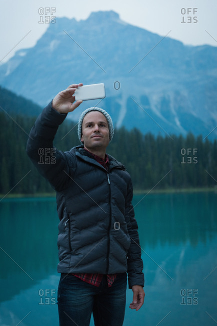 Man taking a selfie near the lake