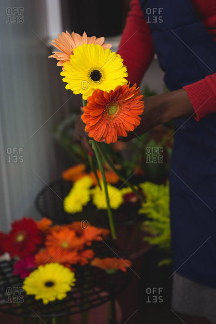Female florist holding flowers