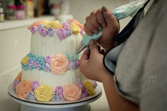 Woman decorating cake in the kitchen