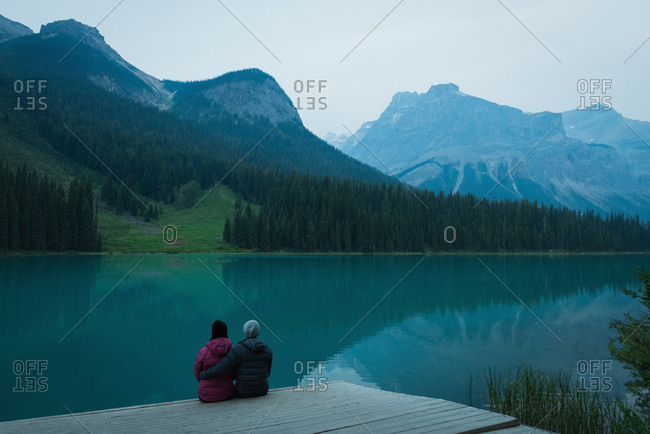 Couple sitting on pier