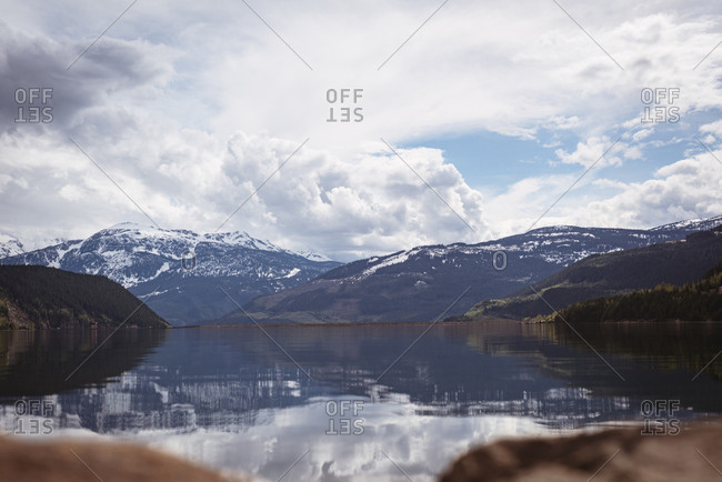 Scenic view of river by snowcapped mountain